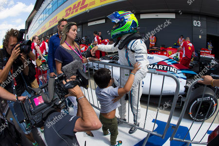 Stock Picture of Williams driver Felipe Massa of Brazil stands with his wife Rafaela Bassi and son Felipinho after qualification before the British Formula One Grand Prix at Silverstone circuit, Silverstone, England, . The British Formula One Grand Prix will be held on Sunday July 5