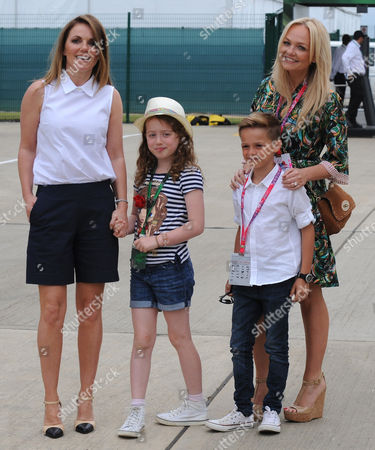 Former Spice girls Emma Bunton with son Beau Lee, right, with Geri Horner and her daughter Bluebell Halliwell in the paddock before the British Formula One Grand Prix at Silverstone circuit, Silverstone, England