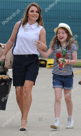 Former Spice girl Geri Horner and her daughter Bluebell Halliwell in the paddock before the British Formula One Grand Prix at Silverstone circuit, Silverstone, England