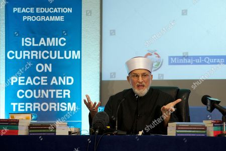 Stock Photo of Pakistan cleric Shaykh-ul-islam Dr Muhammad Tahir-ul-Qadri, the founder of the Minhaj-ul-Quran International organization, delivers a keynote speech at the launch of the Islamic Curriculum on Peace and Counter Terrorism in London, . The curriculum is described by the organizers of the event as a syllabus that provides material to form the basis of educational programs and campaigns against religious extremism and radicalization, and for the promotion of peace