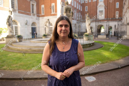Esther Hyman, whose sister Miriam was killed by the explosion on a bus in the 2005 London bombings, poses for a portrait in a courtyard at the British Medical Association building in London