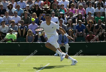 Milos Raonic of Canada runs for a shot during the men's singles first round match against Daniel Gimeno-Traver of Spain at the All England Lawn Tennis Championships in Wimbledon, London