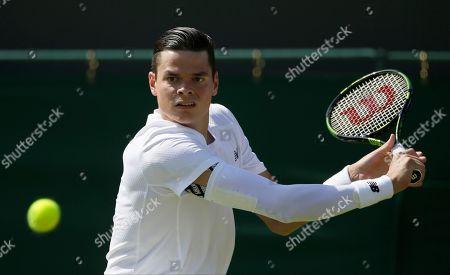 Milos Raonic of Canada plays a return during the men's singles first round match against Daniel Gimeno-Traver of Spain at the All England Lawn Tennis Championships in Wimbledon, London