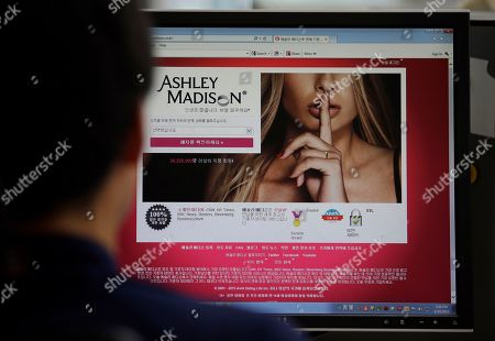 A photo from files showing Ashley Madison's Korean web site on a computer screen in Seoul, South Korea. U.S. government employees with sensitive jobs in national security or law enforcement were among hundreds of federal workers found to be using government networks to access and pay membership fees to the cheating website Ashley Madison, The Associated Press has learned. The list includes at least two assistant U.S. attorneys, an information technology administrator in the White House's support staff, a Justice Department investigator, a division chief, and a government hacker and counterterrorism employee at the Homeland Security Department. Others visited from networks operated by the Pentagon