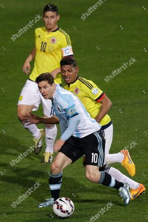 Alexander Mejia, Lionel Messi, James Rodriguez Argentina's Lionel Messi, front, runs with the ball followed by Colombia's Alexander Mejia, center, and Colombia's James Rodriguez, top, during a Copa America quarterfinal soccer match at the Sausalito Stadium in Vina del Mar, Chile