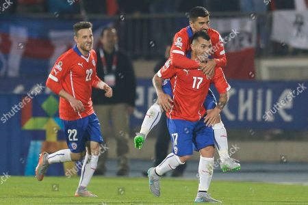 Gary Medel, Angelo Henriquez, David Pizarro Chile's Gary Medel, right, celebrates after scoring against Bolivia with teammates Chile's Angelo Henriquez, left, and Chile's David Pizarro, right top, during a Copa America Group A soccer match at El Nacional stadium in Santiago, Chile
