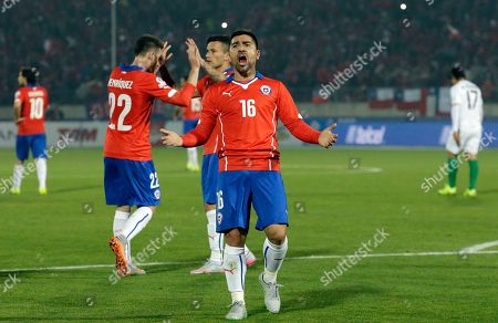 Chile's David Pizarro celebrates an own goal by Bolivia's Ronald Raldes during a Copa America Group A soccer match at El Nacional stadium in Santiago, Chile