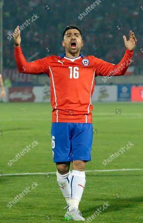 Chile's David Pizarro celebrates an own goal made by Bolivia's Ronald Raldes during a Copa America Group A soccer match at El Nacional stadium in Santiago, Chile