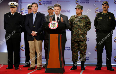 Juan Manuel Santos, Juan Carlos Pinzon, Juan Pablo Rodriguez, Hernando Willis, Rodolfo Palomino Colombia's President Juan Manuel Santos announces that at least 26 leftist rebels have been killed in a raid in western Colombia, as he's accompanied by Navy Commander Adm. Hernando Wills, left, Defense Minister Juan Carlos Pinzon, second from left, Armed Forces Commander Gen. Juan Pablo Rodriguez, second from right, and National Police Chief Gen. Rodolfo Palomino, right, at the presidential palace in Bogota, . Colombia's largest rebel group, the Revolutionary Armed Forces of Colombia (FARC), announced they're ending a unilateral cease-fire in response to the military raid on their guerrilla camp