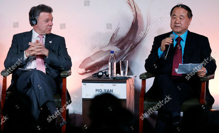 Juan Manuel Santos, Mo Yan Chinese Nobel Prize Laureate for Literature Mo Yan, right, speaks during a Chinese-Colombian literary event as Colombia's President Juan Manuel Santos listens in Bogota, Colombia