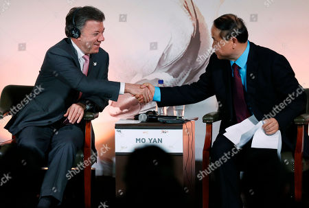 Juan Manuel Santos, Mo Yan Colombia's President Juan Manuel Santos, left, shakes hands with Chinese Nobel Prize Laureate for Literature Mo Yan during a Chinese-Colombian literary event in Bogota, Colombia
