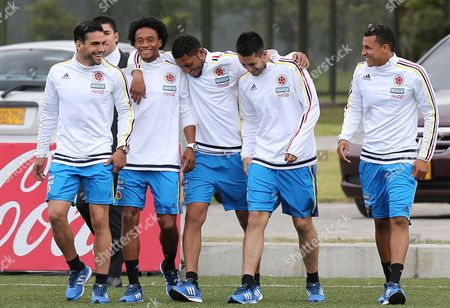 Jeison Murillo, Camilo Vargas, Juan Cuadrado, Radamel Falcao Garcia, Carlos Valdes Colombia's soccer players Jeison Murillo, right, Camilo Vargas, second from right, Juan Cuadrado, second from left, Radamel Falcao Garcia, left, and Carlos Valdes, center, arrive for a press conference in Bogota, Colombia, . Colombia's team members are departing for Argentina where they'll train for the Copa America which starts in June in neighboring Chile