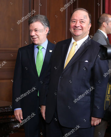 Luis Carlos Villegas, Juan Manuel Santos Colombia's President Juan Manuel Santos, left, stands with Luis Carlos Villegas, his new defense minister, after Villegas' swearing-in ceremony at the presidential palace in Bogota, Colombia, . Villegas replaced Juan Carlos Pinzon who was appointed new ambassador of Colombia in Washington D.C