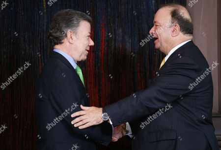 Stock Picture of Luis Carlos Villegas, Juan Manuel Santos Colombia's President Juan Manuel Santos, left, shakes hands with Luis Carlos Villegas, his new Defense Minister after swearing him in at the presidential palace in Bogota, Colombia, . Villegas replaces Juan Carlos Pinzon who was appointed as the new ambassador of Colombia in Washington