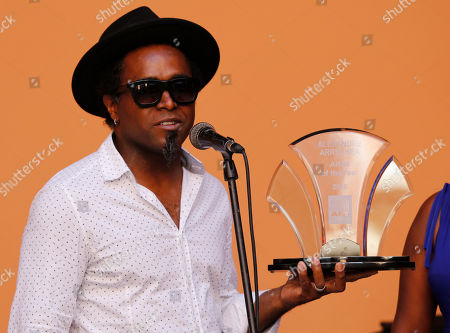 Stock Photo of Cuban sculptor Alexandre Arrechea holds his award from the U.S.-based Farber Foundation, in Havana, Cuba, . Arrechea was named Cuban Artist of the Year by the foundation at a ceremony in Old Havana. The award comes with a $10.000 prize