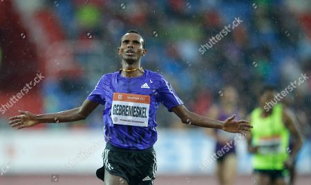 Dejen Gebremeskel from Ethiopia crosses the finish line winning the 5000 meters men event at the Golden Spike Athletic meeting in Ostrava, Czech Republic