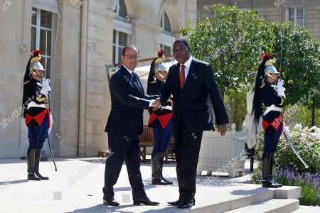 France's President Francois Hollande, left, shakes hands with his counterpart from Benin, Yayi Boni, prior to a meeting, at the Elysee Palace, in Paris
