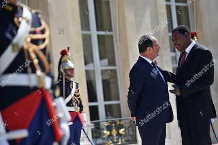 France's President Francois Hollande, left, talks with his counterpart from Benin, Yayi Boni, after a meeting, at the Elysee Palace, in Paris