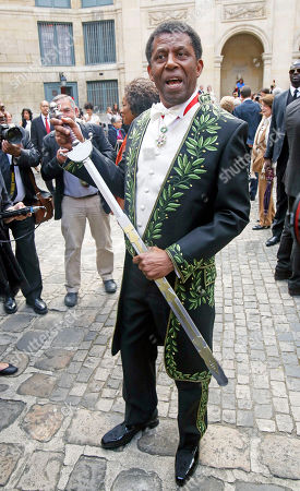 Haitian-born Canadian writer Dany Laferriere poses with his sword after his induction ceremony at the Academie Francaise, French Academy, in Paris, . Dany Laferriere is a Haitian Canadian novelist and journalist who writes in French