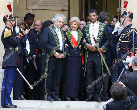 Haitian-born Canadian writer Dany Laferriere, right, poses with Academicians Helene Carrere d'Encausse, center, and Amin Maalouf, left, after his induction ceremony at the Academie Francaise, French Academy, in Paris, . Dany Laferriere is a Haitian Canadian novelist and journalist who writes in French