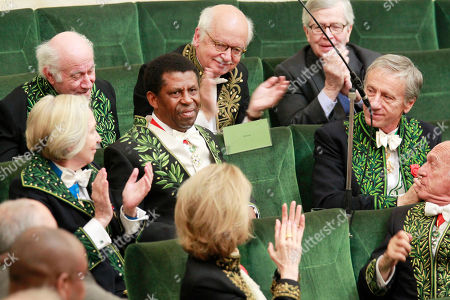 Haitian-born Canadian writer Dany Laferriere acknowledges applause after delivering his speeech during his induction ceremony at the Academie Francaise, French Academy, in Paris, . Dany Laferriere is a Haitian Canadian novelist and journalist who writes in French