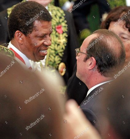 French President Francois Hollande, right, congratulatesHaitian-born Canadian writer Dany Laferriere, left, after his induction ceremony at the Academie Francaise, French Academy, in Paris, . Dany Laferriere is a Haitian Canadian novelist and journalist who writes in French