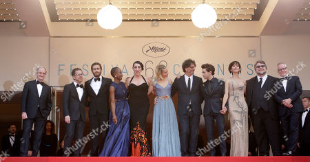 Stock Photo of From left, festival president Pierre Lescure, jury president Ethan Coen, jury members Jake Gyllenhaal, Rokia Traore, Rossy de Palma, Sienna Miller, jury president Joel Coen, jury members Xavier Dolan, Sophie Marceau, Guillermo Del Toro and festival director Thierry Fremaux pose for photographers upon arrival for the awards ceremony at the 68th international film festival, Cannes, southern France