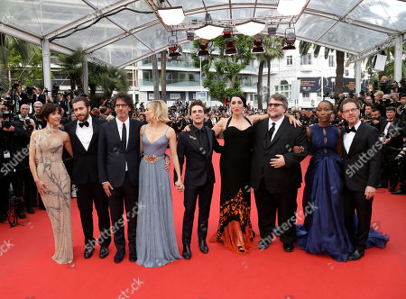 From left, jury members Sophie Marceau, Jake Gyllenhaal, Joel Coen, Sienna Miller, Xavier Dolan, Rossy de Palma, Guillermo Del Toro, Rokia Traore and jury president Ethan Coen pose for photographers upon arrival for the awards ceremony at the 68th international film festival, Cannes, southern France