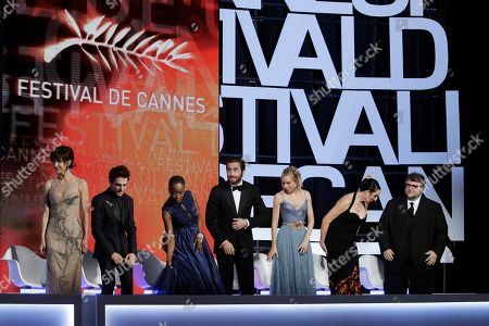 From left, jury members Sophie Marceau, Xavier Dolan, Rokia Traore, Jake Gyllenhaal, Sienna Miller, Rossy de Palma and Guillermo Del Toro take their seats during the awards ceremony at the 68th international film festival, Cannes, southern France