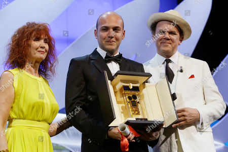 Director Cesar Augusto Acevedo, center, holds Camera d'Or award which was presented to him by actor John C. Reilly, right, and actress Sabine Azema during the awards ceremony at the 68th international film festival, Cannes, southern France