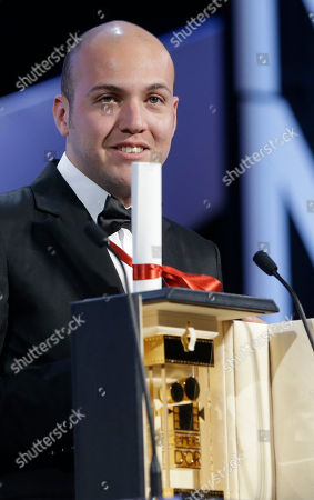 Director Cesar Augusto Acevedo stands alongside the Camera d'Or award for La Tierra y la Sombra during the awards ceremony at the 68th international film festival, Cannes, southern France