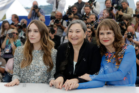 From left, Sarah Sutherland, Robin Bartlett and Nailea Norvind pose for photographers during a photo call for the film Chronic, at the 68th international film festival, Cannes, southern France