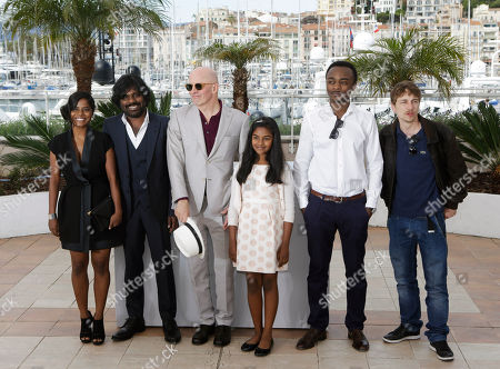 From left, actress Kalieaswari Srinivasan, Jesuthasan Antonythasan, director Jacques Audiard, actors Claudine Vincent Rottiers, Marc Zinga and Vincent Rottiers pose for photographers during a photo call for the film Dheepan, at the 68th international film festival, Cannes, southern France