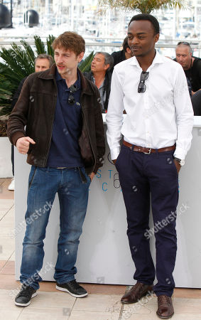 Actors Vincent Rottiers and Marc Zinga pose for photographers during a photo call for the film Dheepan, at the 68th international film festival, Cannes, southern France