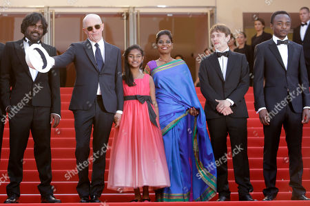 Jesuthasan Antonythasan, Jacques Audiard, Claudine Vinasithamby, Kalieaswari Srinivasan, Vincent Rottiers, Marc Zinga From left, Jesuthasan Antonythasan, director Jacques Audiard, Claudine Vinasithamby, Kalieaswari Srinivasan, Vincent Rottiers and Marc Zinga pose for photographers upon arrival for the screening of the film Dheepan at the 68th international film festival, Cannes, southern France