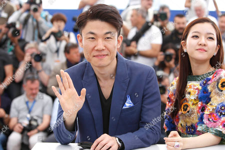 From left, director Hong Won-chan, and actress Ko Ah-sung, pose for photographers during a photo call for the film O Piseu (Office), at the 68th international film festival, Cannes, southern France