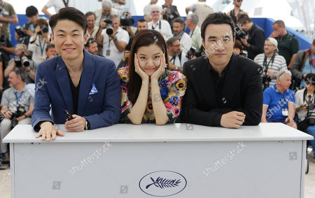 Stock Image of From left, director Hong Won-chan, actors Ko Ah-sung, and Bae Sung-woo during a photo call for the film O Piseu (Office), at the 68th international film festival, Cannes, southern France