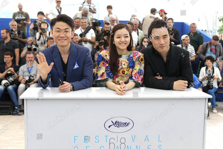 From left, director Hong Won-chan, actors Ko Ah-sung, and Bae Sung-woo pose for photographers during a photo call for the film O Piseu (Office), at the 68th international film festival, Cannes, southern France