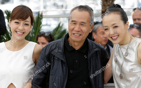 From left, actress Hsieh Hsin-Ying, director Hou Hsiao-Hsien, and actress Sheu Fang-Yi pose for photographers during a photo call for the film Nie Yinniang (The Assassin), at the 68th international film festival, Cannes, southern France