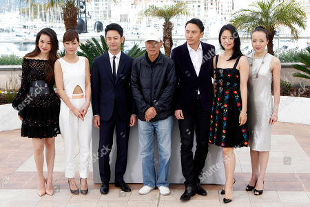 From left, actors Zhou Yun, Hsieh Hsin-Ying, Tsumabuki Satoshi, director Hou Hsiao-Hsien, actors Chang Chen, Zhou Yun, and Sheu Fang-Yi pose for photographers during a photo call for the film Nie Yinniang (The Assassin), at the 68th international film festival, Cannes, southern France