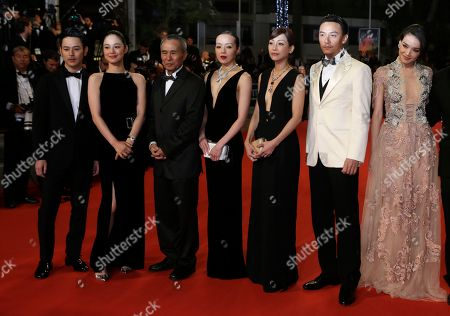 From left, actors Tsumabuki Satoshi, Zhou Yun, director Hou Hsiao-Hsien, actors Sheu Fang-Yi, Hsieh Hsin-Ying, Chang Chen and Shu Qi pose for photographers as they arrive for the screening of the film Nie Yinniang (The Assassin) at the 68th international film festival, Cannes, southern France