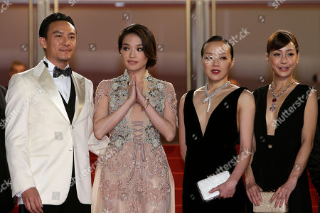 From left, actors Chang Chen, Shu Qi, Sheu Fang-Yi, and Hsieh Hsin-Ying pose for photographers as they arrive for the screening of the film Nie Yinniang (The Assassin) at the 68th international film festival, Cannes, southern France