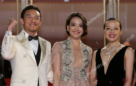 From left, actors Chang Chen, Shu Qi, and Sheu Fang-Yi pose for photographers as they arrive for the screening of the film Nie Yinniang (The Assassin) at the 68th international film festival, Cannes, southern France