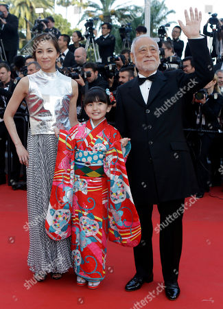 From left, actors Asako Seto, Rio Suzuki, and Masahiko Tsugawa pose for photographers upon arrival for the screening of the film The Little Prince at the 68th international film festival, Cannes, southern France