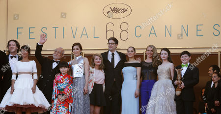 Stock Image of From left, actors Guillaume Gallienne, Florence Foresti, Masahiko Tsugawa, Rio Suzuki, Asako Seto, Clara Poincare, director Mark Osborne, actors Marion Cotillard, Charlotte Vandermeersch, Mackenzie Foy, and Riley Osborne pose for photographers upon arrival for the screening of the film The Little Prince at the 68th international film festival, Cannes, southern France