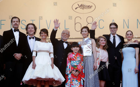 From left, actors Laurent Lafitte, Guillaume Gallienne, Florence Foresti, Masahiko Tsugawa, Rio Suzuki, Asako Seto, Clara Poincare, director Mark Osborne, and actress Marion Cotillard pose for photographers upon arrival for the screening of the film The Little Prince at the 68th international film festival, Cannes, southern France
