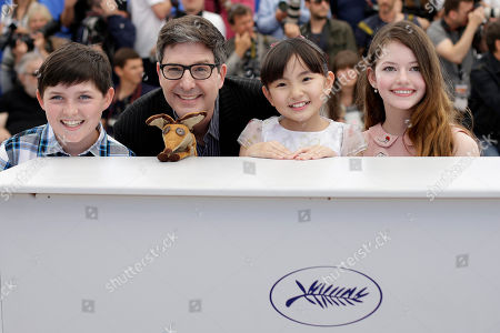 From left, actor Riley Osborne, director Mark Osborne, actors Rio Suzuki and Mackenzie Foy pose for photographers during a photo call for the film The Little Prince, at the 68th international film festival, Cannes, southern France
