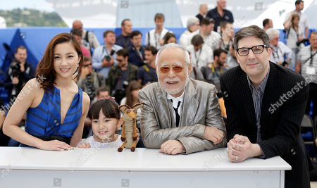 From left, actors Asako Seto, Rio Suzuki, Masahiko Tsugawa and director Mark Osborne pose for photographers during a photo call for the film The Little Prince, at the 68th international film festival, Cannes, southern France