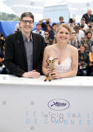 Director Mark Osborne, left, and actress Charlotte Vandermeersch pose for photographers during a photo call for the film The Little Prince, at the 68th international film festival, Cannes, southern France