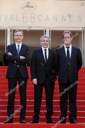 From left, actor Christophe Rossignon, director Stephane Brize, and Vincent Lindon pose for photographers as they arrive for the screening of the film La Loi du Marche (The Measure of a Man) at the 68th international film festival, Cannes, southern France